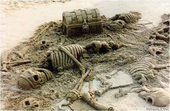 figura de arena esqueletos y cofre