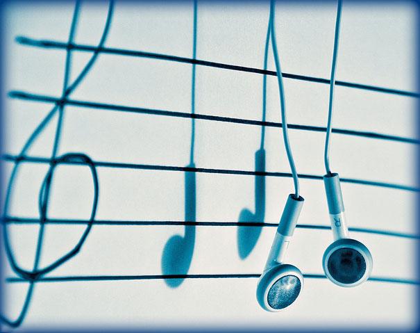 notas partitura auriculares sombra