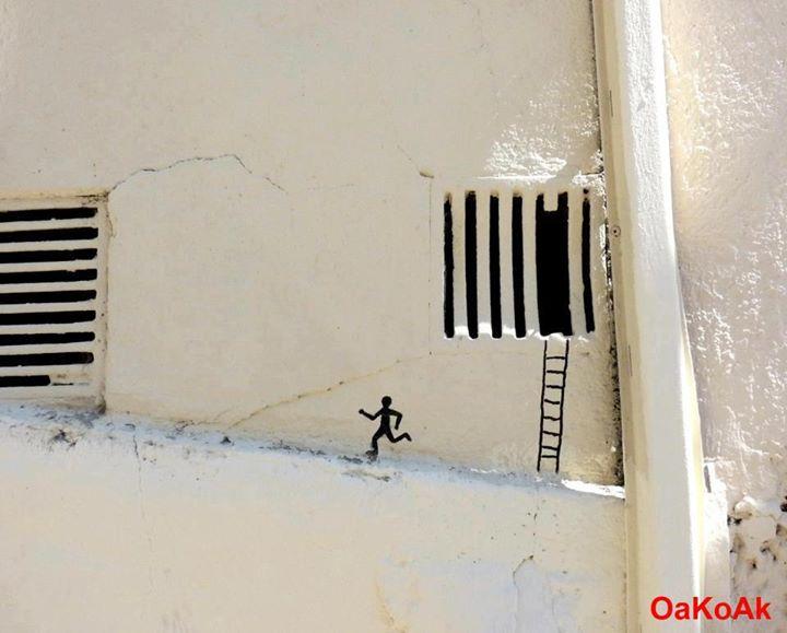 arte urbano hombre escapando por rendija