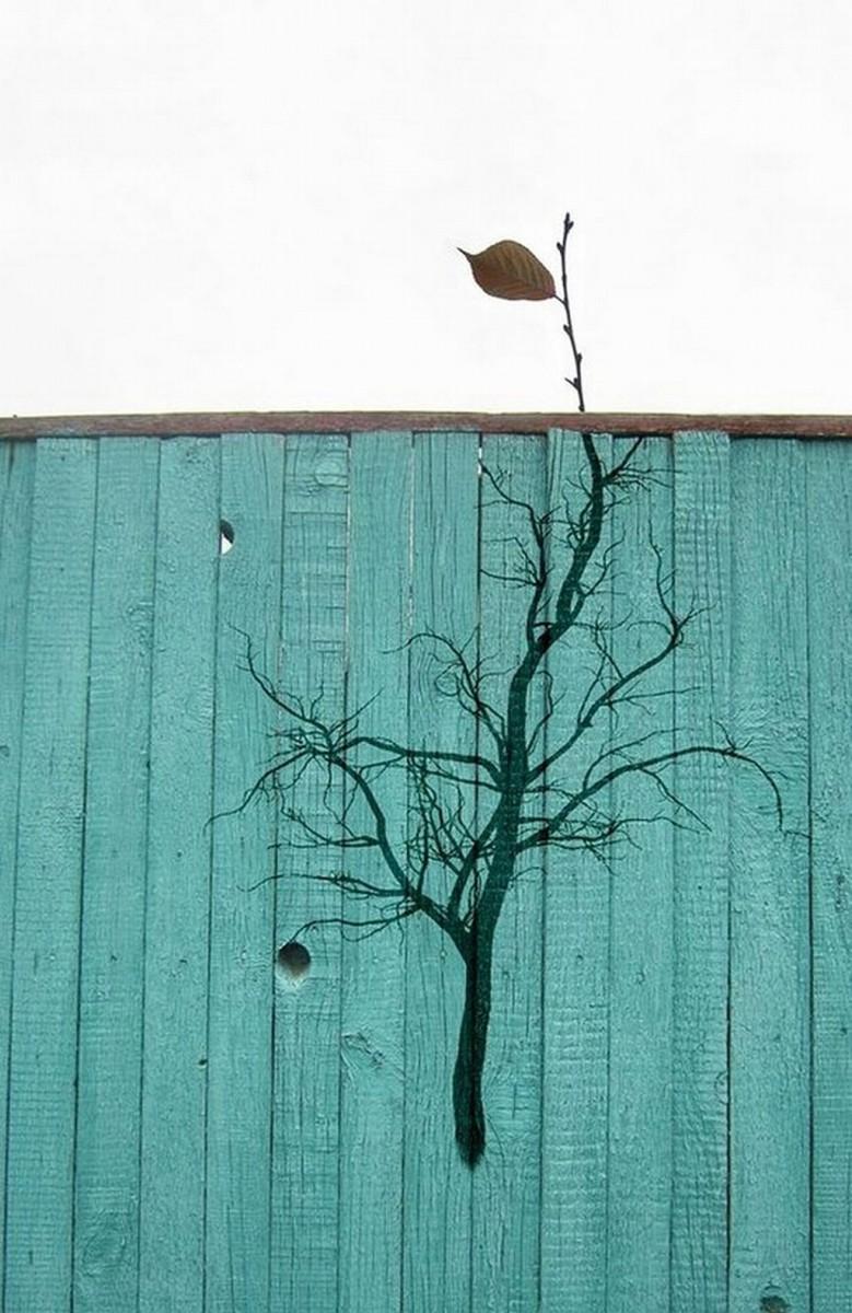 arte urbano arbol pintado y rama real