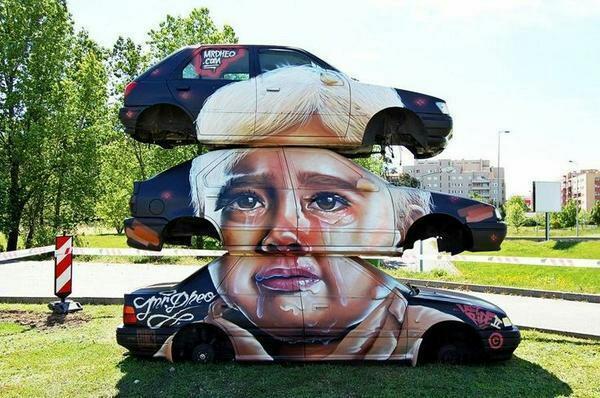 arte-urbano-chasis-de-coches-con-dibujo