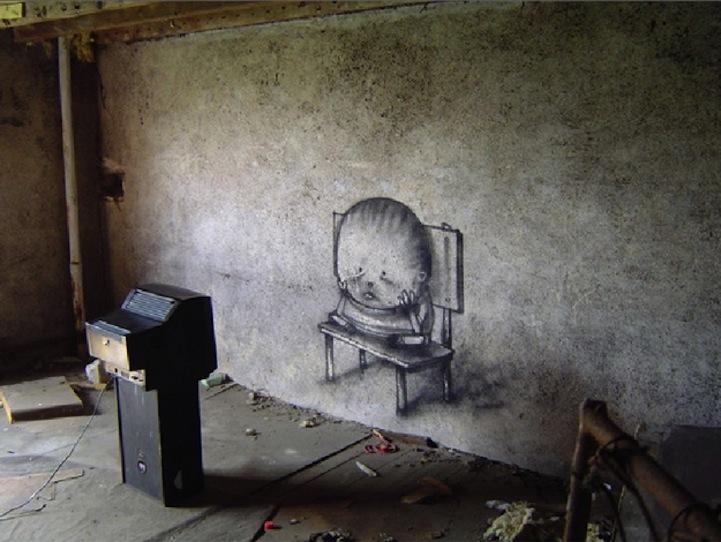arte-urbano-dibujo-de-nino-sentado-viendo-la-tele