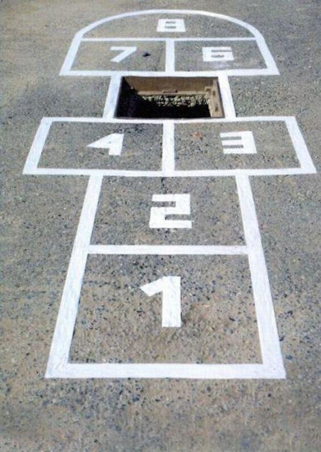 Arte Urbano - Juego para avisar de agujero
