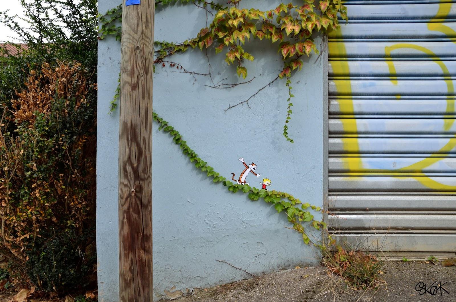 arte urbano persoajes de dibujos animados caminando por enredadera