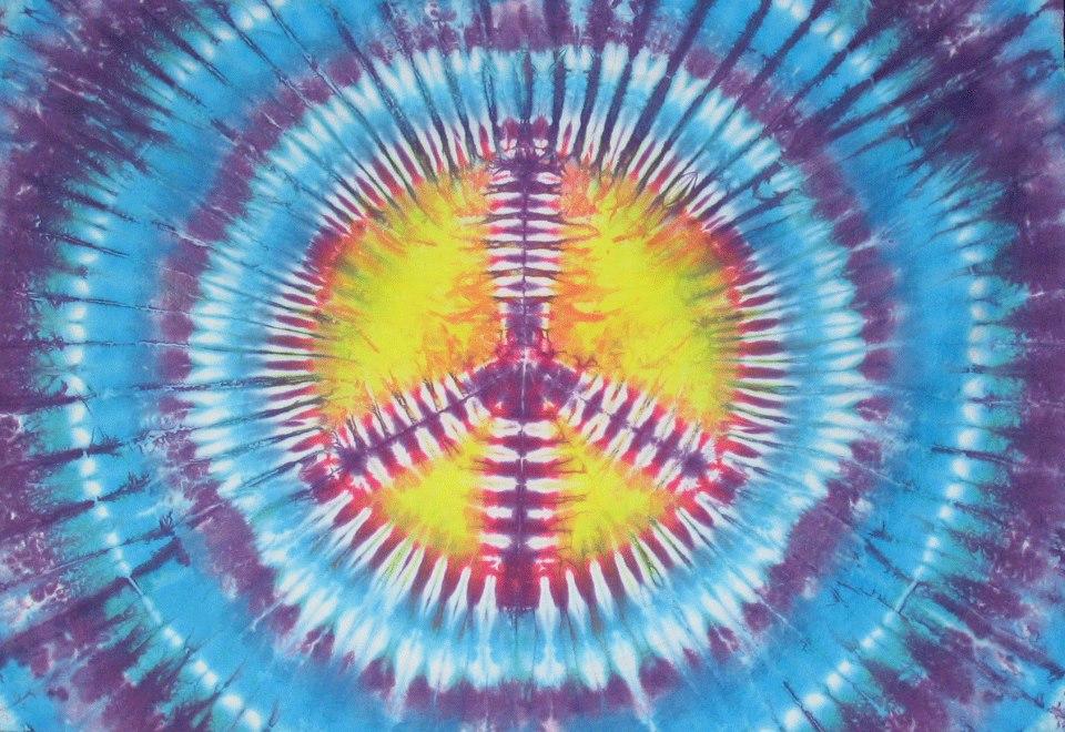 simbolo paz de colores años 70